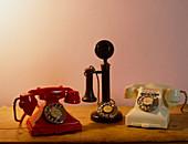 Three old Bakelite telephones