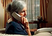 Woman talking on telephone