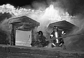 Firemen fighting a house fire