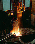 Superalloy charge being drawn from furnace