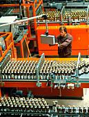 Worker on a fruit juice bottling production line