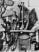 Water wheel powering a machine for making cloth