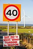 Wind turbine protest sign