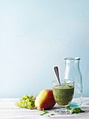 A green smoothie with fruit and wild herbs
