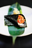 Temaki sushi with salmon and sesame seeds