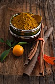 Curry, cinnamon sticks and an orange