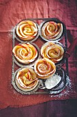 Apple roses with apricots and icing sugar