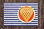 Waffle heart on an orange plate
