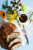Spelt bread, tea and a bunch of flowers