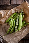 Broad beans on brown paper