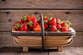 Fresh strawberries in a wooden basket