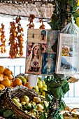 Pictures of saints hanging from a market stand in Positano, Amalfi coast, Italy