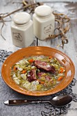 Winter vegetable stew with gherkins and bacon
