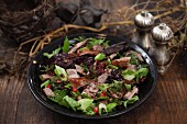 Autumnal mixed leaf salad with beef
