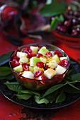 Fruit salad with melon, apple, cherries and lemon