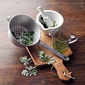 Wormwood oil à la Hildegard von Bingen being made: wormwood being juiced