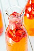 Freshly made strawberry vinegar in a bottle
