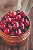 Cranberries in a copper pot