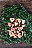 Heart-shaped gingerbread surrounded by pine sprigs