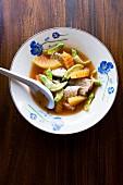 Gaeng Som Sai Pla (orange fish curry with vegetables, Thailand)