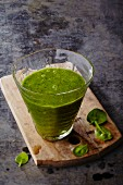 A green smoothie with spinach and avocado