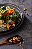 Sauerkraut salad with lamb's lettuce, papaya and nuts