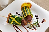 A lamb kebab with courgette