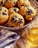 Blueberry muffins and a jar of honey
