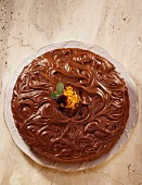 Chocolate cake with artistic chocolate glaze
