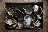 Various old metal baking tins
