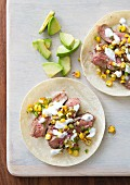 Flank steak tacos with sweetcorn, coriander, sour cream and avocado (Mexico)