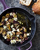 Warm marinated artichoke hearts with olive oil, Kalamata olives, thyme and feta cheese
