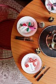 Minimalist table with cross motifs and name cards on a plate