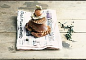 A stack of crab and shells on a piece of newspaper