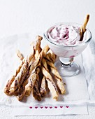 Cinnamon sticks with raspberry cream for Christmas