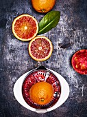 Blood oranges with a stainless steel juicer