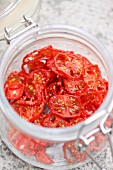 Sun-dried cherry tomatoes in preserving jar