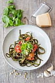 Seaweed pasta with basil pesto and tomatoes
