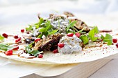 Persian chicken wraps with rocket and pomegranate