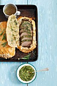 Saddle of land with pesto baked in a salt crust