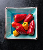 Fresh mini peppers in a turquoise bowl