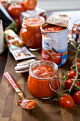 Tomatoes in a jar, fresh vine tomatoes, tinned tomatoes and tomato purée