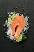 Fresh salmon steak on crushed ice and lime slices