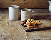 Chocolate and hazelnut cookies on an old wooden tray