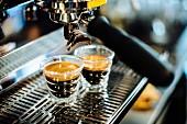 Glasses of espresso on a coffee machine