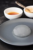 Mizu Shingen Mochi (Japanese raindrop cake) on a grey plate