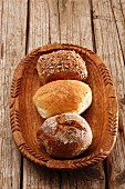 A rye bread roll, a wheat bread roll and a wholemeal roll