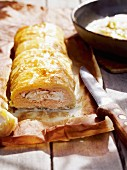 Salmon strudel on baking paper