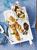 Grilled chicken skewers with olive pesto and foil-baked vegetables