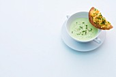 Foamy herb soup with egg crostini